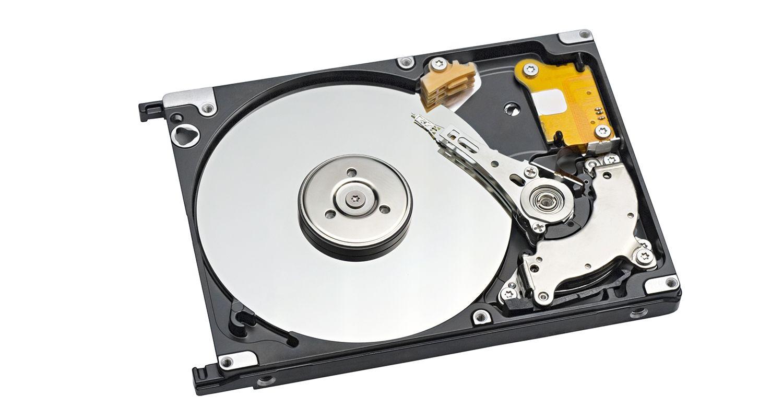 展示旋轉碟片與致動懸臂的硬碟。